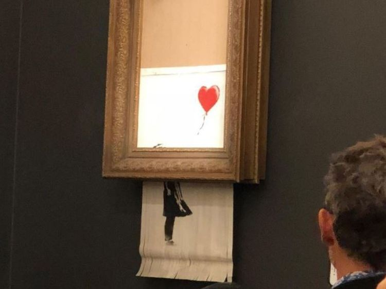 Banksy's Girl With Red Balloon mysteriously shreds after its sale at Sotheby's London. Pic: Sotheby's