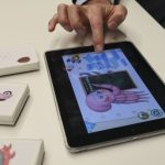 Traditional toys, mobile games join forces for child development