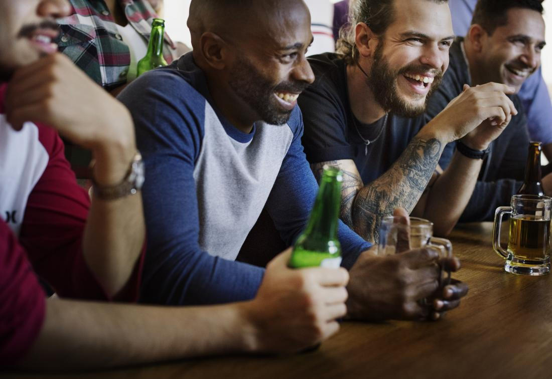 group of male friends drinking in a bar