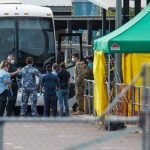 China ban extends as evacuees arrive in NT